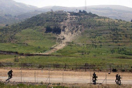 <p>Israeli soliders patrol along the ceasefire line between the Israeli-occupied Golan Heights and Syria, on June 6, 2011. Israel forces have carried out an air strike overnight on a weapons convoy from Syria near the Lebanese border, security sources told AFP on condition of anonymity.</p>