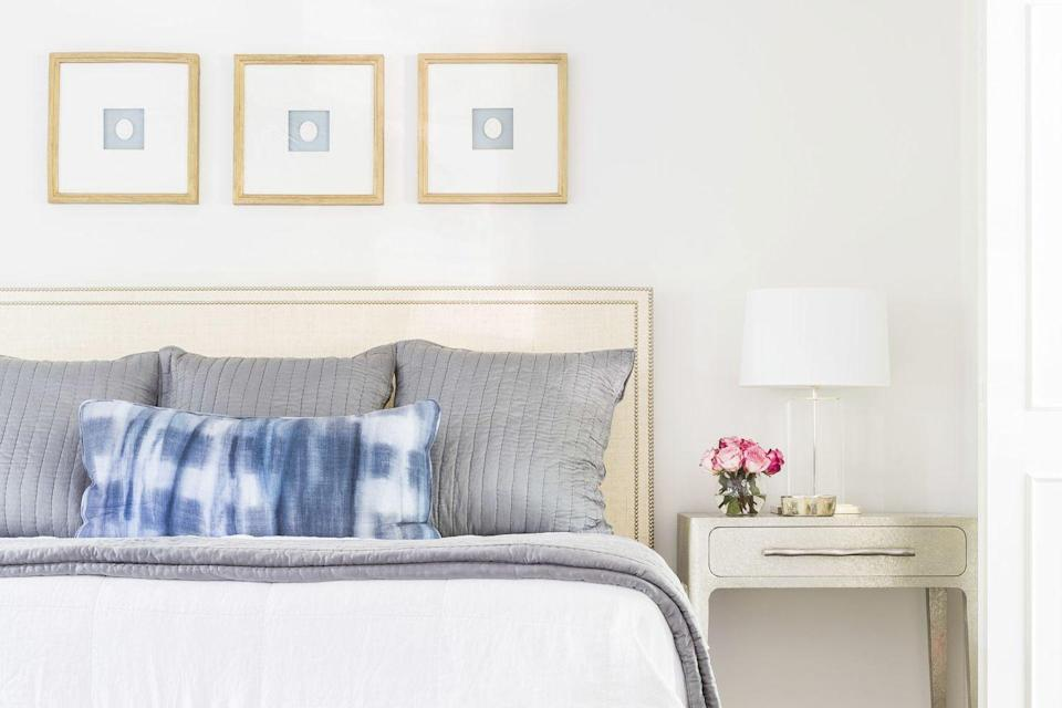 "<p>Try this trick from designer <a href=""https://melbeaninteriors.com/"" rel=""nofollow noopener"" target=""_blank"" data-ylk=""slk:Mel Bean"" class=""link rapid-noclick-resp"">Mel Bean</a> to fill up space when you can't afford big pieces of art: Hang multiple, uniform-sized picture frames, with simple artwork, side-by-side above your bed.</p>"