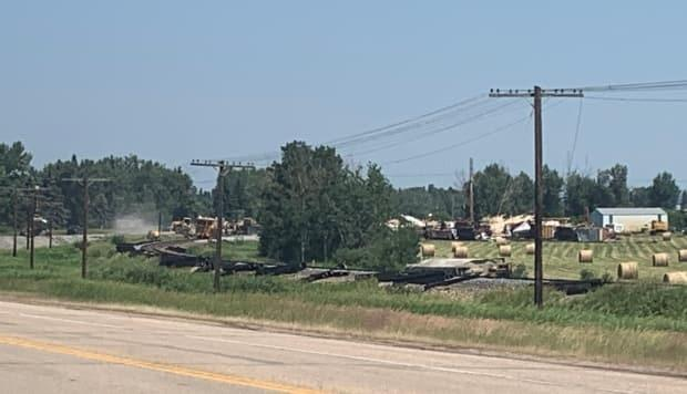 Emergency crews says that 23 train cars derailed near Highway 2A in Lacombe County, Alta., on Friday evening. (Craig Ryan/CBC News - image credit)