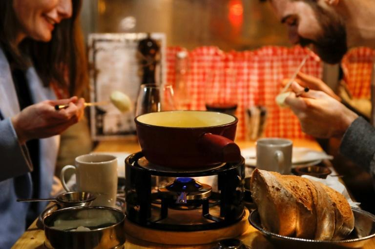 Swiss cheese fondue is traditionally involves several people dipping bread into the same pot