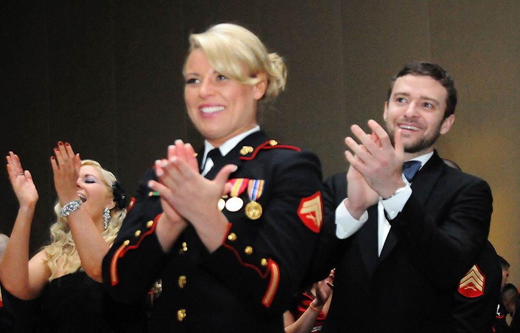 "Justin Timberlake is a man of his word! The 30-year-old singer and actor made good on his promise to Corporal Kelsey De Santis, who asked him earlier this year via video to accompany her to the Marine Corps Ball in Richmond, Virginia. In case you were wondering, there was no goodnight kiss after Saturday night's event. ""We just all gave hugs and parted our ways,"" DeSantis told ""Good Morning America."" ""He was a complete gentleman."" This Friday, JT's ""Friends With Benefits"" co-star Mila Kunis attended a ball in Greenville, North Carolina, with a Marine Sergeant. It's the new Hollywood trend! (11/12/2011)"