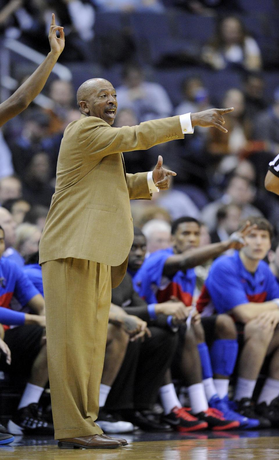 DePaul coach Oliver Purnell gestures during the second half of an NCAA college basketball game against Georgetown, Tuesday, Dec. 31, 2013, in Washington. Georgetown won 61-54. (AP Photo/Nick Wass)