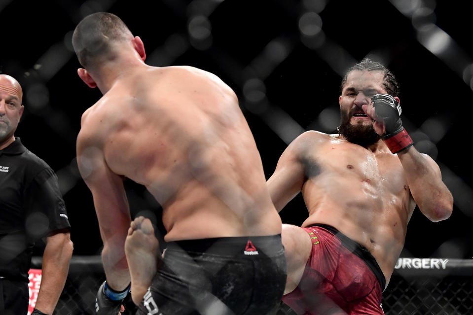 """Jorge Masvidal (right) throws a kick at Nate Diaz during the """"BMF"""" championship bout at UFC 244 on Saturday at Madison Square Garden. (Photo by Steven Ryan/Getty Images)"""