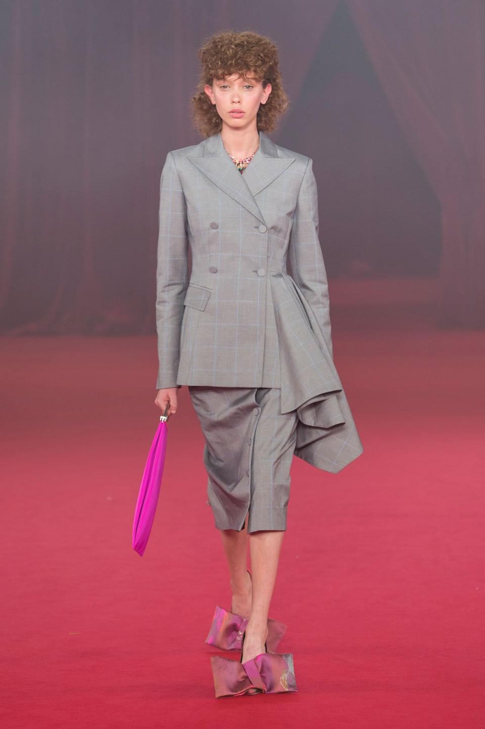 <p>Gray ruffled jacket and skirt from the SS18 Off- White collection. (Photo: ImaxTree) </p>