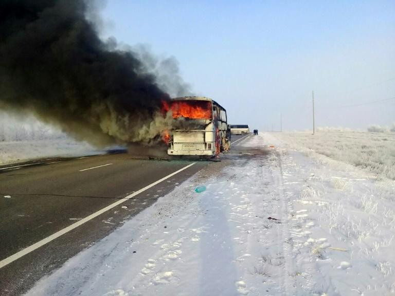 A burning bus on a road in the region around the city of Aktobe