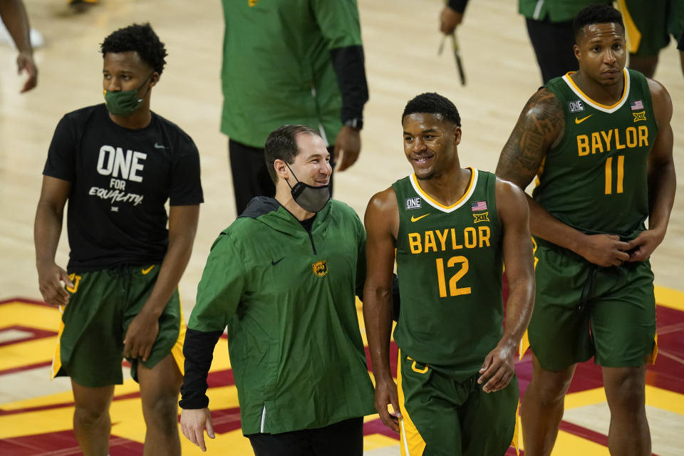 Baylor head coach Scott Drew walks off the court with guard Jared Butler (12) after an NCAA college basketball game against Iowa State, Saturday, Jan. 2, 2021, in Ames, Iowa. Baylor won 76-65. (AP Photo/Charlie Neibergall)