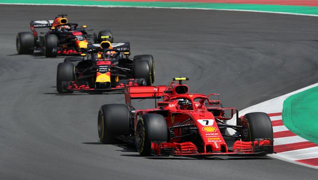 Formula One F1 - Spanish Grand Prix - Circuit de Barcelona-Catalunya, Barcelona, Spain - May 13, 2018 Ferrari's Kimi Raikkonen in action ahead of Red Bull's Max Verstappen during the race REUTERS/Albert Gea