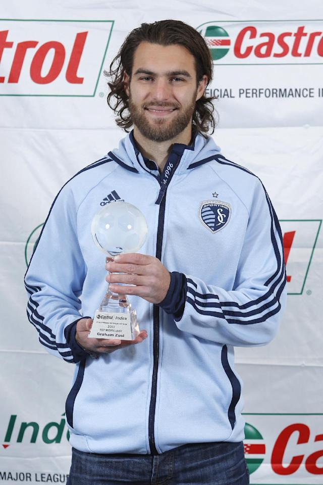 IMAGE DISTRIBUTED FOR CASTROL GTX HIGH MILEAGE - Sporting Kansas City's Graham Zusi accepts the Castrol Index 2013 Top MLS Midfielder Award Friday, Dec. 6, 2013, in Kansas City, Kan. (Ed Zurga/AP Images for Castrol GTX High Mileage)