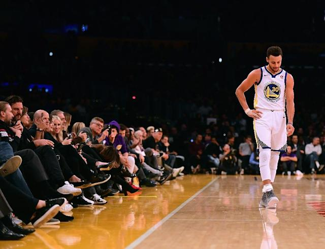 The Golden State Warriors mounted a second-half comeback to defeat the New Orleans Pelicans 125-115, but at the cost of an injury to Stephen Curry (AFP Photo/Harry How)