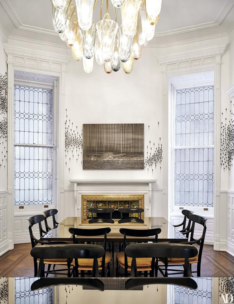 A Teresita Fernández graphite installation covers the dining room walls. Tables by Vica.