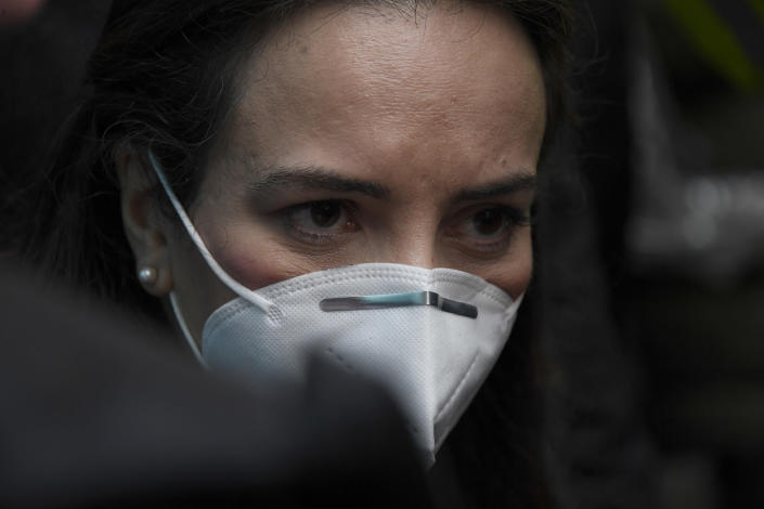 """Stella Moris girlfriend of Julian Assange waits to gain entry to Westminster Magistrates Court for his Bail hearing in London, Wednesday, Jan. 6, 2021. On Monday Judge Vanessa Baraitser ruled that Julian Assange cannot be extradited to the US. because of concerns about his mental health. Assange had been charged under the US's 1917 Espionage Act for """"unlawfully obtaining and disclosing classified documents related to the national defence"""". Assange remains in custody, the US. has 14 days to appeal against the ruling. (AP Photo/Alberto Pezzali)"""