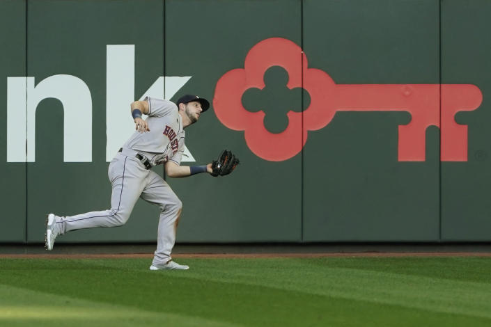 Houston Astros right fielder Kyle Tucker catches a fly ball hit by Seattle Mariners' Dylan Moore during the third inning of a baseball game Saturday, April 17, 2021, in Seattle. (AP Photo/Ted S. Warren)