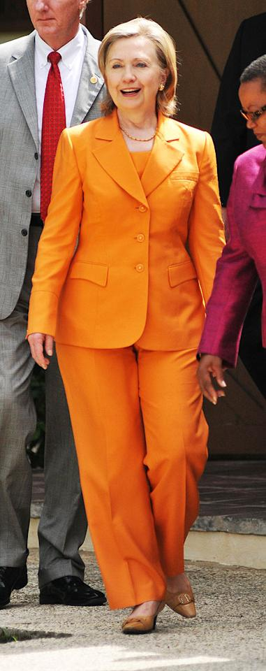 "Bright and bold orange hues are perfect for summer when used in moderation. When used from head to toe in the form of a pantsuit ... not so much. Take note, Hillary! Islandpaps/<a href=""http://www.splashnewsonline.com"" target=""new"">Splash News</a> - June 10, 2010"
