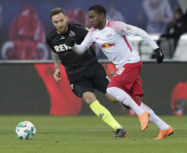 Leipzig's Ademola Lockmann, right, and Cologne's Marco Hoeger challenge for the ball during the German Bundesliga soccer match between RB Leipzig and FC Cologne in Leipzig, eastern Germany, Sunday, Feb. 25, 2018. (Soeren Stache/dpa via AP)