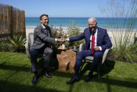 President Joe Biden and French President Emmanuel Macron shake hands as they visit during a bilateral meeting at the G-7 summit, Saturday, June 12, 2021, in Carbis Bay, England. (AP Photo/Patrick Semansky)