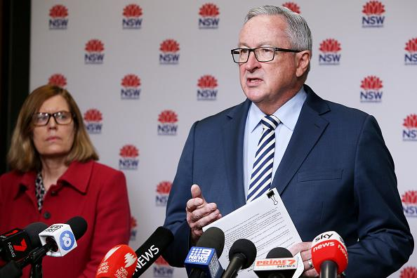 New South Wales Health Minister Brad Hazzard speaks as Chief Health Officer Dr Kerry Chant looks on. Source: Getty Images