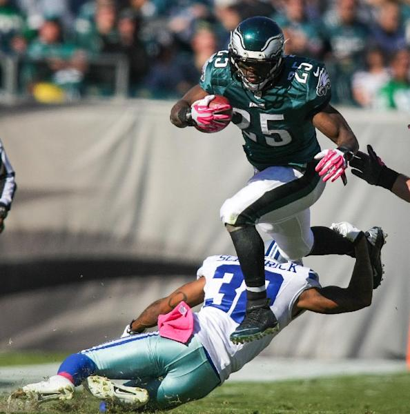 Philadelphia Eagles running back LeSean McCoy (25) jumps over Cowboys' Orlando Scandrickan NFL football game on Sunday, Oct. 20, 2013, in Philadelphia. (AP Photo/The Wilmington News-Journal, Suchat Pederson)