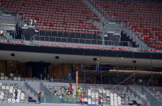 Workers are seen inside Al Bayt stadium built for the upcoming 2022 FIFA World Cup soccer championship, during a stadium tour, in Al Khor