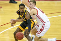 Wisconsin's Tyler Wahl (5) reaches in on Arkansas-Pine Bluff's Shaun Doss (21) during the first half of an NCAA college basketball game Friday, Nov. 27, 2020, in Madison, Wis. (AP Photo/Andy Manis)