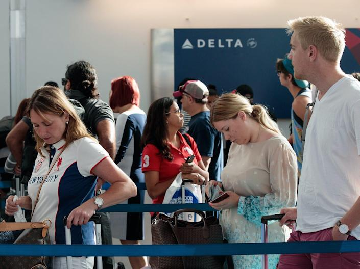 Long airport lines at Delta Air Lines check-in.