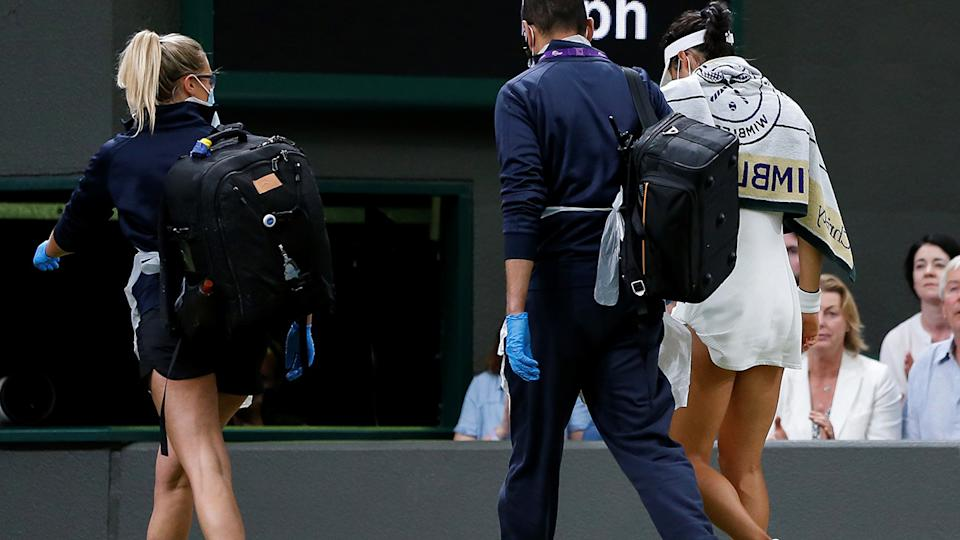 Emma Raducanu, pictured here leaving the court for a medical timeout at Wimbledon.