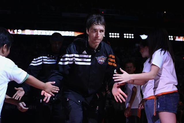 PHOENIX, AZ - APRIL 25: Steve Nash #13 of the Phoenix Suns high fives fans as he is introduced before the NBA game against the San Antonio Spurs at US Airways Center on April 25, 2012 in Phoenix, Arizona. The Spurs defeated the Suns 110-106. NOTE TO USER: User expressly acknowledges and agrees that, by downloading and or using this photograph, User is consenting to the terms and conditions of the Getty Images License Agreement. (Photo by Christian Petersen/Getty Images)