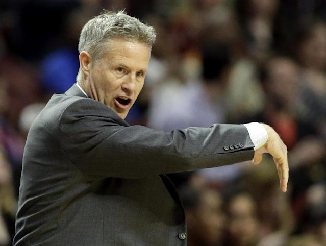 Philadelphia 76ers coach Brett Brown talks to his team during the first half of an NBA basketball game against the Chicago Bulls in Chicago on Saturday, March 22, 2014. (AP Photo/Nam Y. Huh)