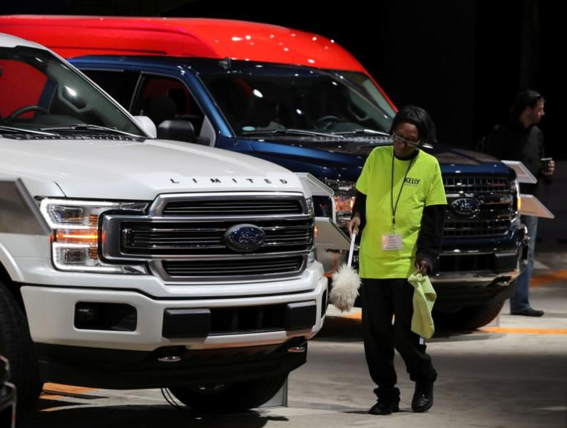 sbFILE PHOTO: Worker cleans Ford pickup truck at the North American International Auto Show in Detroit, Michigan