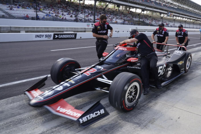 The crew pushes the car of Will Power, of Australia, to the qualification line during qualifications for the Indianapolis 500 auto race at Indianapolis Motor Speedway, Saturday, May 22, 2021, in Indianapolis. (AP Photo/Darron Cummings)