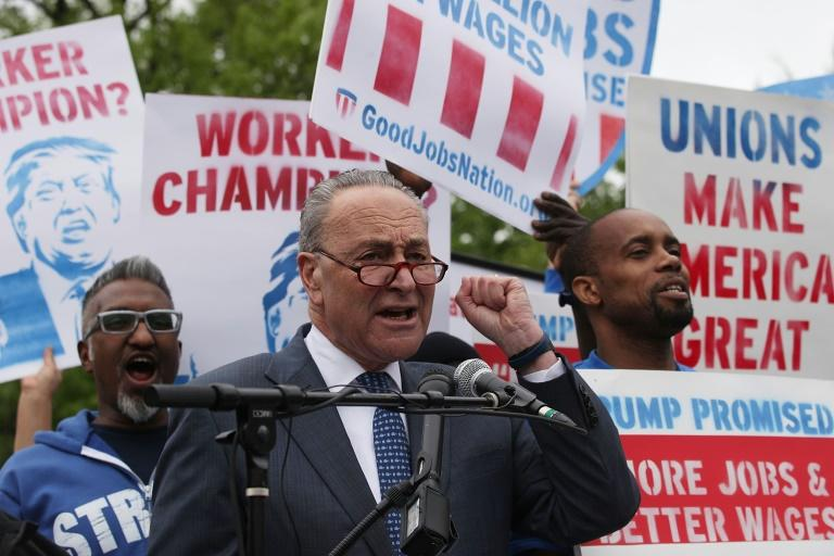 US Senate Minority Leader Charles Schumer speaks during a rally in front of the Capitol to call for a $15 minimum wage and rights to form unions