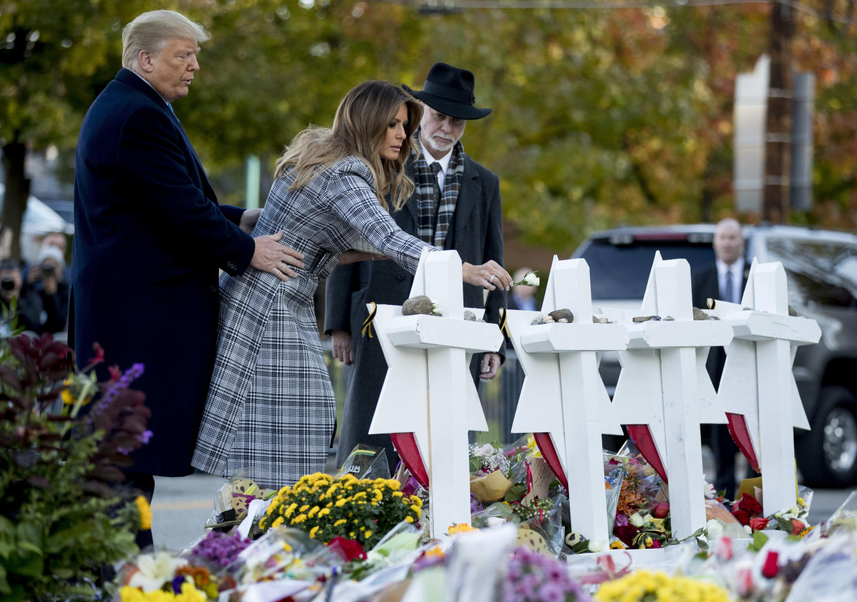 First lady Melania Trump, accompanied by President Trump and Rabbi Jeffrey Myers, right, pays her respects at the Tree of Life synagogue. (Photo: Andrew Harnik/AP)
