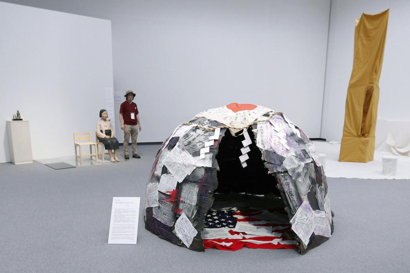 This Aug. 3, 2019, photo, shows artworks for an exhibition in Nagoya, central Japan. The exhibit, part of Aichi Triennale 2019 art festival, resumed after it was forced to close down following threat over a statue of wartime Korean women sexually abused by Japanese soldiers. (Kyodo News via AP)