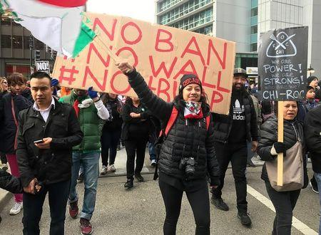 "Demonstrators march during the ""Day Without Immigrants"" protest in Chicago"