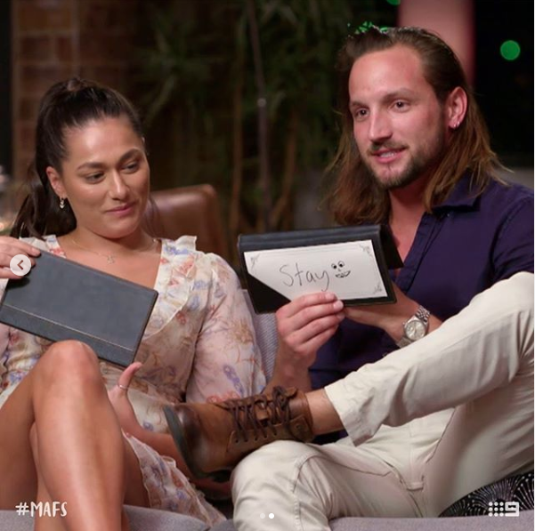 Married At First Sight's Jonethen and Connie on the couch during the show