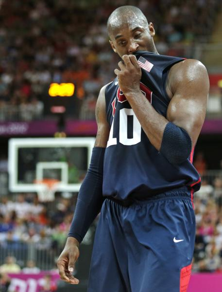 USA's Kobe Bryant pauses during a men's basketball game against Lithuania at the 2012 Summer Olympics, Saturday, Aug. 4, 2012, in London. (AP Photo/Charles Krupa)