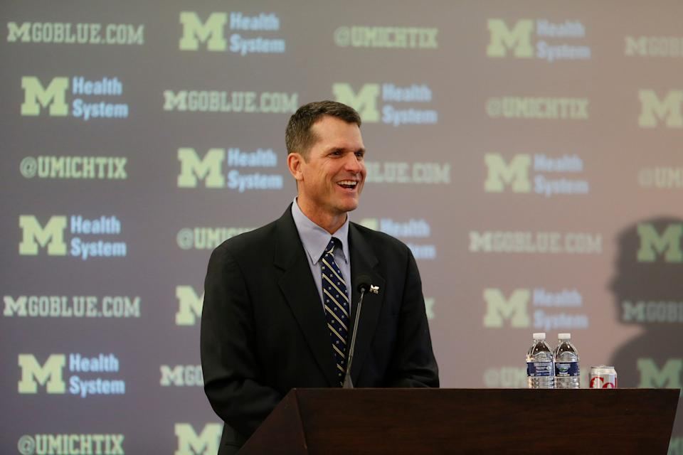 Jim Harbaugh answering questions as the new Michigan University head football coach during press conference at the Junge Center in Ann Arbor on Tuesday, December 30, 2014.