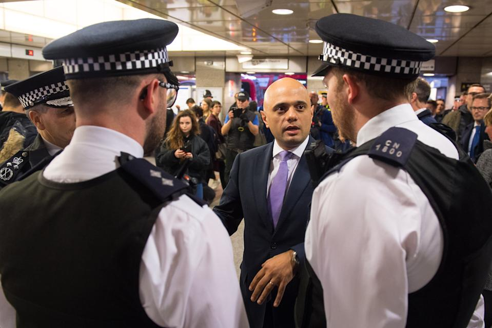 Home Secretary Sajid Javid speaks with police officers during a visit to Angel underground station to announce plans to allow more police officers enhanced stop and search powers as part of continued action to tackle to knife crime.