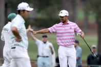 Xander Schauffele reacts to his eagle putt on the 15h hole during the third round of the Masters golf tournament at Augusta National, Saturday, April 10, 2021, in Augusta, Ga. (Curtis Compton/Atlanta Journal-Constitution via AP)
