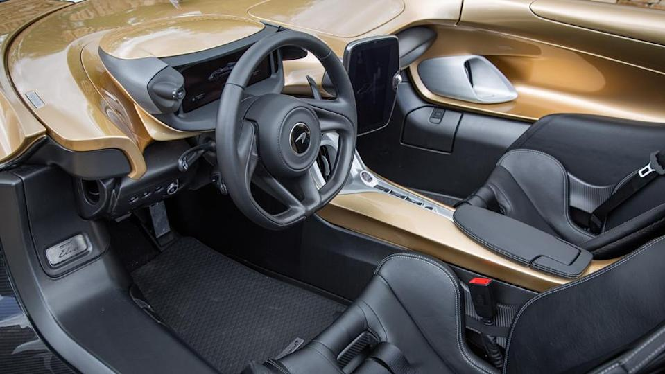The driver is positioned high in the seat with the door tops at roughly chest level. - Credit: Photo by Chris Brown, courtesy of McLaren Automotive Limited.