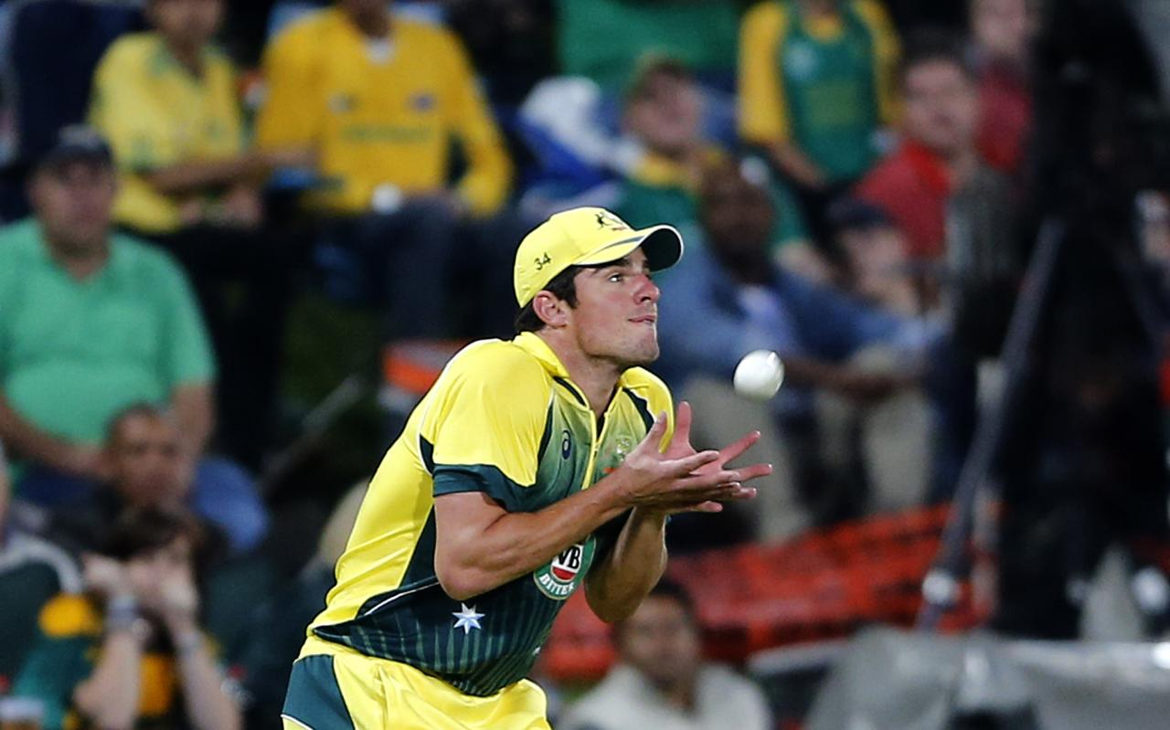 Australia's Moises Henriques makes a catch to dismiss South Africa's JP Duminy during the final of the T20 cricket test match in Centurion, March 14, 2014. REUTERS/Siphiwe Sibeko (SOUTH AFRICA - Tags: SPORT CRICKET)