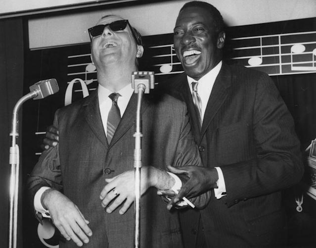 (FILE PHOTO) 29th September 1962: British jazz pianist George Shearing (left) and American singer Joe Williams (1918 - 1999) attend a press reception in London, before beginning a tour of Britain together. Shearing, who was born blind, has not performed in Britain for fifteen years. Shearing has died at 91 years old. (Photo by Central Press/Getty Images)