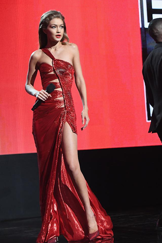 <p>Coming out with a bang! For the show's opening monologue, the model wore a red Atelier Versace gown that was custom made just for her. The Jessica Rabbit-inspired number featured multiple cutouts on the bodice and a one-shoulder detail as well as a high leg slit. While her Melania Trump impression fell a little flat, she certainly looked just like a '90s supermodel. <em>(Photo: Getty Images)</em> </p>