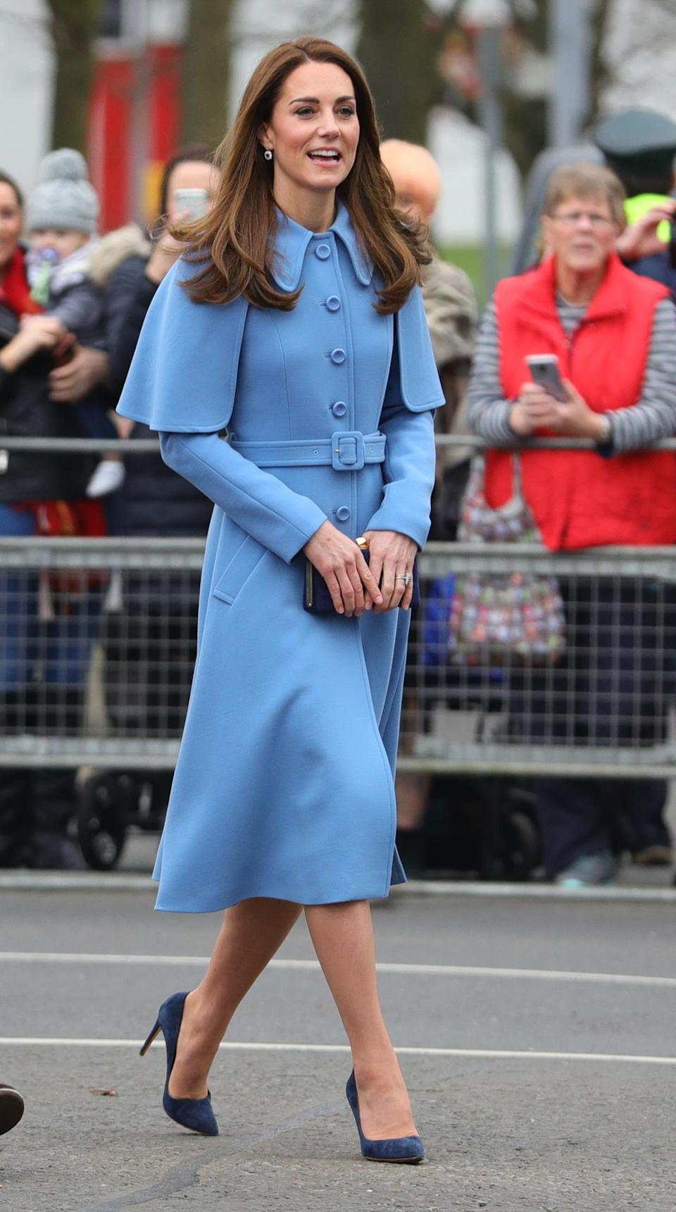 During a visit to Ballymena in Northern Ireland, Kate debuted a new powder blue coat from Mulberry, with a repeat blue Jenny Packham dress underneath and her Rupert Sanderson navy courts. She accessorised with a matching Jimmy Choo clutch bag and Princess Diana's sapphire and diamond earrings. [Photo: PA]