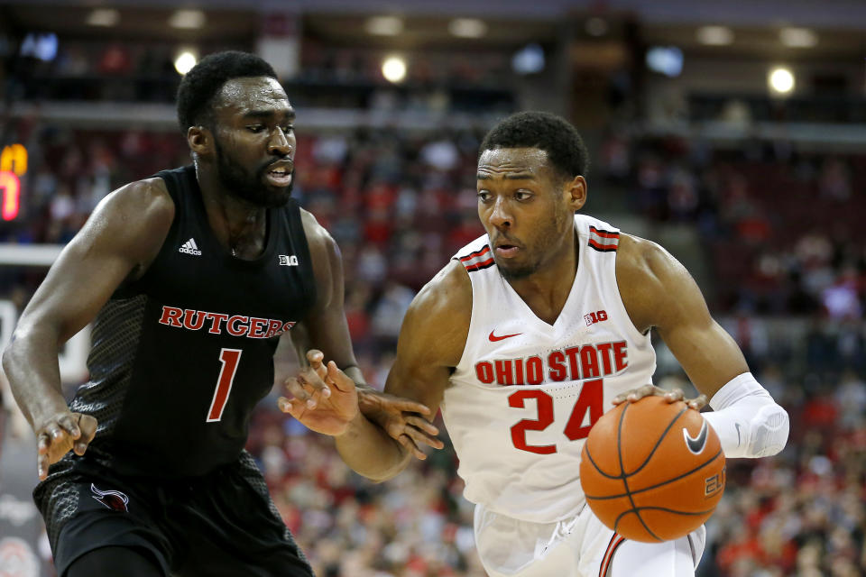 Feb 12, 2020; Columbus, Ohio, USA; Ohio State Buckeyes forward Andre Wesson (24) drives against Rutgers Scarlet Knights forward Akwasi Yeboah (1) during the first half at Value City Arena. Mandatory Credit: