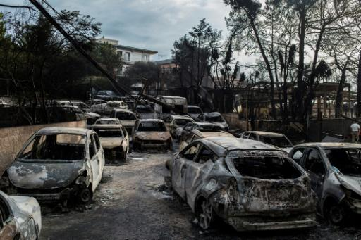 Dozens of cars were burnt in the Greek village of Mati, near Athens