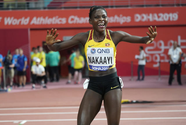 Halimah Nakaayi, of Uganda celebrates as she wins the gold medal in the women's 800 meter final at the World Athletics Championships in Doha, Qatar, Monday, Sept. 30, 2019. (AP Photo/David J. Phillip)