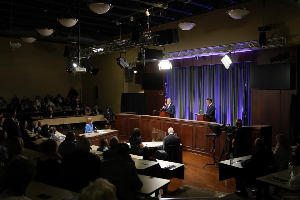 Democratic gubernatorial candidate and former governor Terry McAuliffe, back center, gestures as his Republican challenger, Glenn Youngkin, back right, looks on during a debate at the Appalachian School of Law in Grundy, Va., Thursday, Sept. 16, 2021. (AP Photo/Steve Helber)