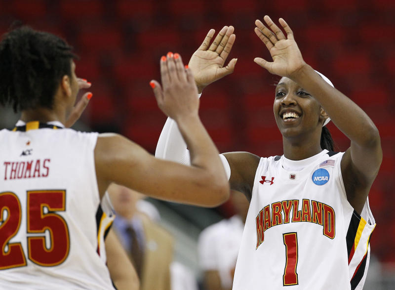 Maryland's Alyssa Thomas (25) and Laurin Mincy (1) react following an NCAA college women's tournament regional semifinal basketball game against Texas A&M in Raleigh, N.C., Sunday, March 25, 2012. Maryland won 81-74. (AP Photo/Gerry Broome)