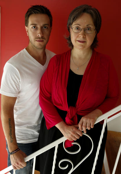 In this portrait taken Wednesday, Aug. 22, 2012, Germaine Maurer, left, and her son Jared Maurer, 28, pose for the Associated Press in their home in Piscataway, N.J. Germaine Maurer's other son, Ben Maurer, went missing when he was 17 in 2002. He was identified through advanced DNA technology and new federal funding through a program aimed at identifying bodies at New York's Hart Island, better known as potter's field. Already the project has identified about 50 of the 54 bodies that have been disinterred. (AP Photo/Julio Cortez)