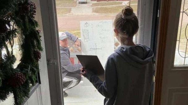 PHOTO: Chris Waba, a middle school math teacher, helps student Rylee Anderson, 12, with her homework in Madison, South Dakota. (Courtesy Josh Anderson)